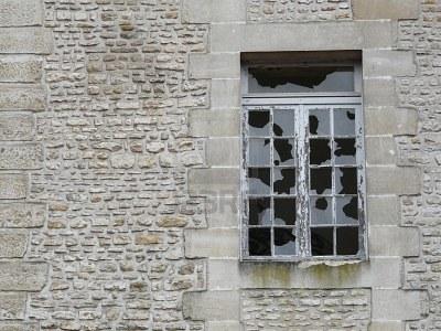 4014776-broken-windows-in-a-derelict-stone-building