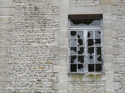 4014776-broken-windows-in-a-derelict-stone-building